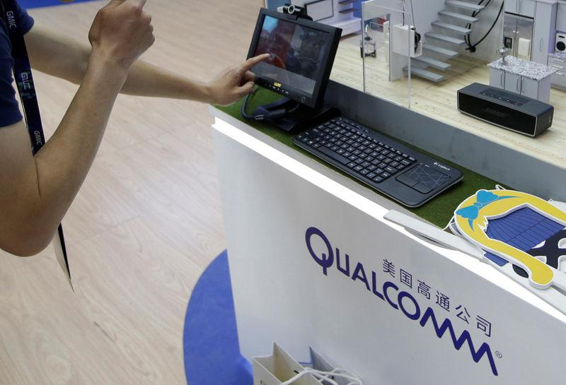 A man visits Qualcomm's booth at the GMIC in Beijing