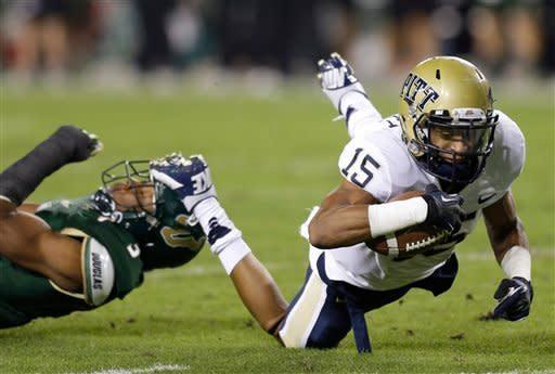 Pittsburgh wide receiver Devin Street (15) dives for an extra yard after getting tripped up by South Florida safety JaQuez Jenkins (3) during the first half of an NCAA college football game Saturday, Dec. 1, 2012, in Tampa, Fla. (AP Photo/Chris O'Meara)