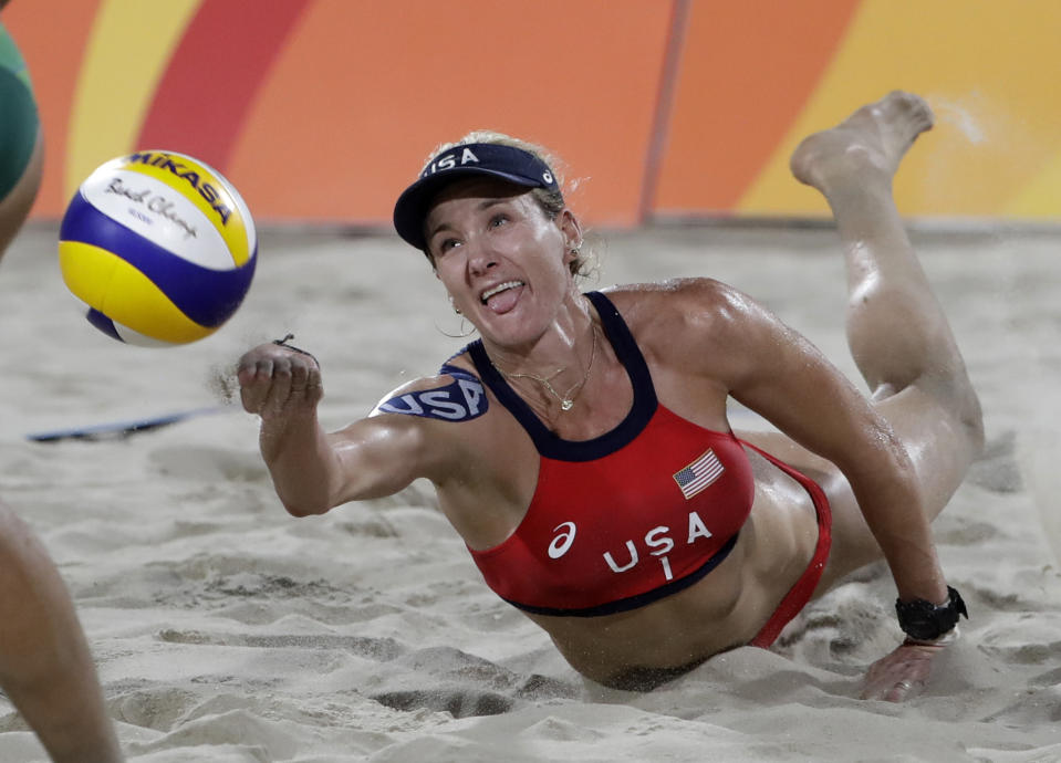 Kerri Walsh Jennings digs for a ball while playing Brazil during the women's beach volleyball bronze medal match of the Summer Olympics in Rio de Janeiro, Brazil. During the coronavirus pandemic, beach volleyball star Walsh Jennings has been doing online talks with young volleyball players, including one with the team at her alma mater of Archbishop Mitty H.S. in California. (AP Photo/Marcio Jose Sanchez, File)