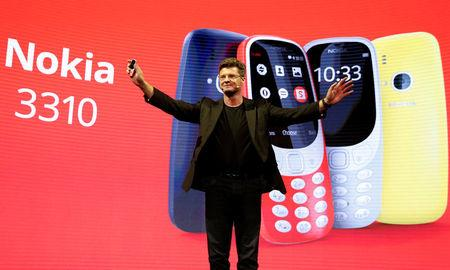 Arto Nummela, CEO of Nokia-HMD, holds up a Nokia 3310 device during a presentation ceremony at Mobile World Congress in Barcelona, Spain, February 26, 2017. REUTERS/Paul Hanna