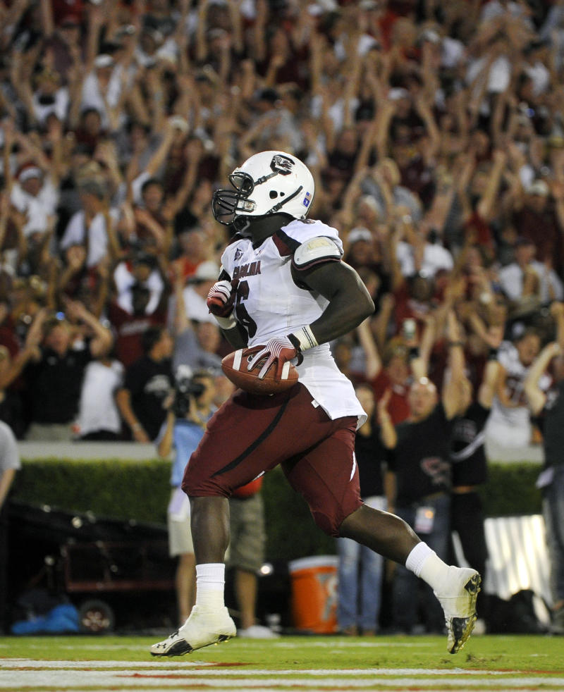 South Carolina defensive end Melvin Ingram scores after a Georgia fumble during the fourth quarter of an NCAA college football game, Saturday, Sept. 10,  2011, in Athens, Ga. South Carolina won 45-42. (AP Photo/John Amis)