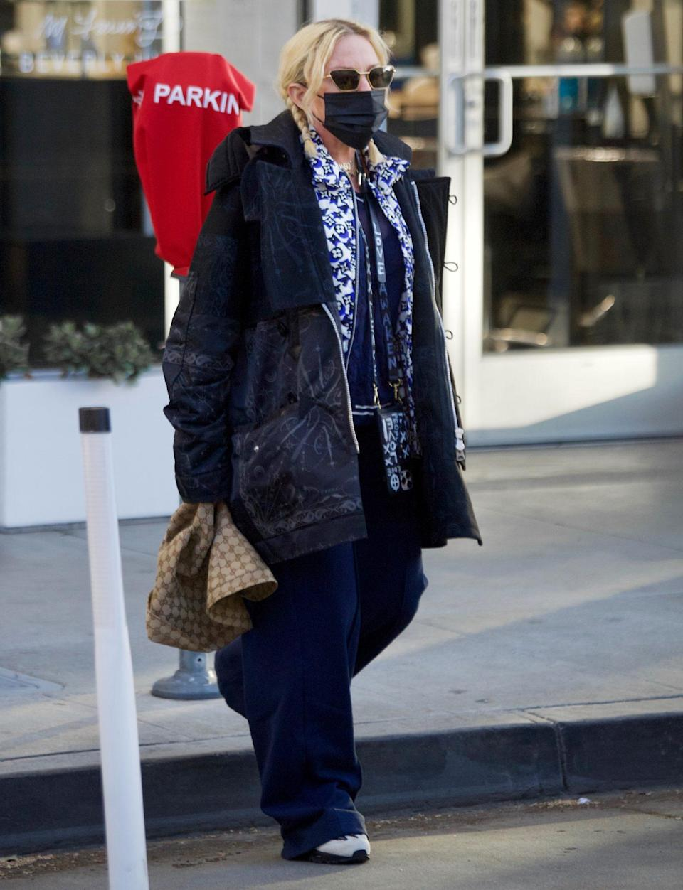 <p>Madonna shows off her street style in lots of loose layers as she heads to a dermatologist in Beverly Hills on Monday. </p>