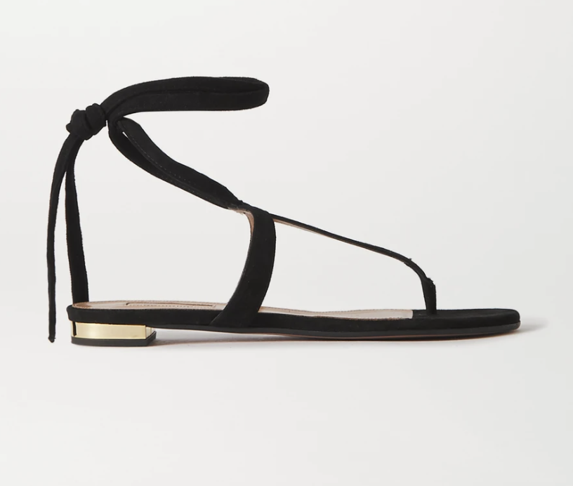 """<p><strong>Aquazzura</strong></p><p>Net-A-Porter</p><p><strong>$416.50</strong></p><p><a href=""""https://go.redirectingat.com?id=74968X1596630&url=https%3A%2F%2Fwww.net-a-porter.com%2Fen-us%2Fshop%2Fproduct%2Faquazzura%2Fshoes%2Fflat%2Fjune-suede-sandals%2F22831760542542449&sref=https%3A%2F%2Fwww.townandcountrymag.com%2Fstyle%2Fg36610169%2Fnet-a-porter-sale-royal-brands-summer-2021%2F"""" rel=""""nofollow noopener"""" target=""""_blank"""" data-ylk=""""slk:Shop Now"""" class=""""link rapid-noclick-resp"""">Shop Now</a></p><p><em>Original Price: $595</em></p><p>Meghan opted for bespoke Aquazzura heels on her wedding day and the brand's iconic Deneuve pumps has quickly <a href=""""https://www.townandcountrymag.com/society/tradition/g27244254/meghan-markle-favorite-shoes/"""" rel=""""nofollow noopener"""" target=""""_blank"""" data-ylk=""""slk:become her signature"""" class=""""link rapid-noclick-resp"""">become her signature</a>. As we head into summer, you can't go wrong with a pair of these classic T-bar sandals. <em><br></em></p>"""