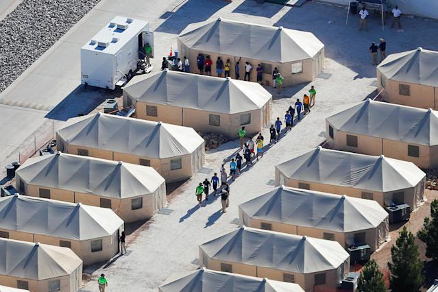 "Immigrant children housed in a tent encampment under the new ""zero-tolerance"" policy of the Trump administration walk in a single file at the facility near the Mexican border in Tornillo, Texas, on June 19, 2018. (Photo: Mike Blake/Reuters)"
