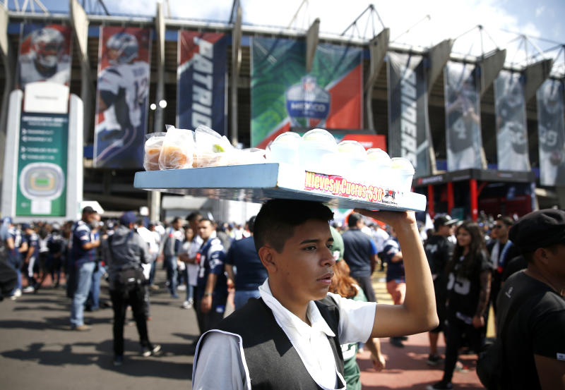 MEXICO CITY, NOVEMBER 19: A vendor sells snacks outside of Estadio Azteca before the start of the 2017 NFL Mexico Game between the New England Patriots and Oakland Raiders in Mexico City, Nov. 19, 2017. (Photo by Jessica Rinaldi/The Boston Globe via Getty Images)