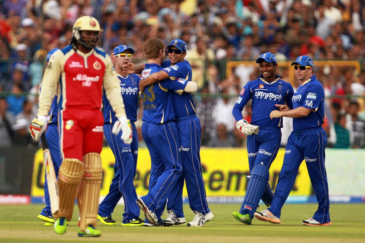 Shane Watson is congratulated by his teammates after taking the wicket of Chris Gayle during match 40 of the Pepsi Indian Premier League ( IPL) 2013  between The Rajasthan Royals and the Royal Challengers Bangalore held at the Sawai Mansingh Stadium in Jaipur on the 29th April 2013. (BCCI)