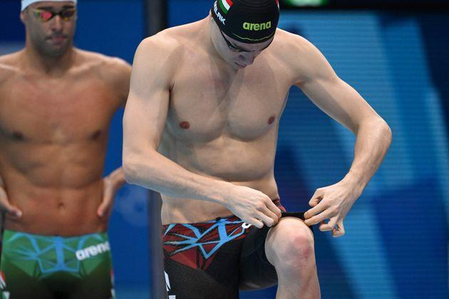 Kristof Milak adjusts his swim trunks ahead of the final of the men's 200-meter butterfly final at the Tokyo Olympics. (Photo: JONATHAN NACKSTRAND via Getty Images)