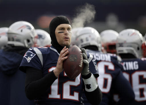 FILE - In this Dec. 31, 2017, file photo, New England Patriots quarterback Tom Brady keeps limber on the sideline in the cold weather during the first half of an NFL football game against the New York Jets, in Foxborough, Mass. His coach downplays it, but Tom Brady knows the cold-weather New England Patriots should have an advantage when they host the warm-weather Los Angeles Chargers in Sundays AFC Divisional Round game. (AP Photo/Charles Krupa, File)