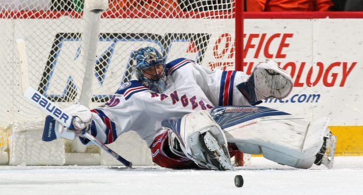 Henrik Lundqvist hasn't looked like his cool, calm self too often this season. (Len Redkoles/NHLI via Getty Images)
