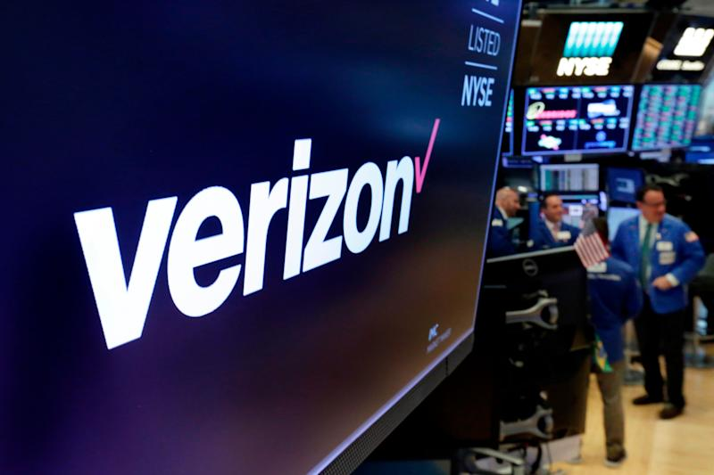 FILE- This April 23, 2018, file photo shows the logo for Verizon above a trading post on the floor of the New York Stock Exchange. Verizon is undergoing a significant restructuring under new CEO Hans Vestberg, including its dominant wireless division, as it prepares to roll out its 5G technology. Three months after Vestberg took control, Verizon said Monday, Nov. 5, that the company will be organized into four groups at the start of the year: Consumer, Business, Media, and Global Network & Technology. (AP Photo/Richard Drew, File)