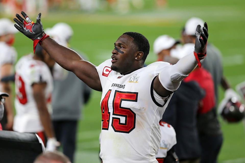 TAMPA, FL - FEBRUARY 07: Devin White (45) of the Buccaneers appeals to the fans to cheer louder during the Super Bowl LV game between the Kansas City Chiefs and the Tampa Bay Buccaneers on February 7, 2021 at Raymond James Stadium, in Tampa, FL. (Photo by Cliff Welch/Icon Sportswire via Getty Images)