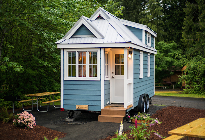 """<p>The most popular option in Tumbleweed Tiny House Company's fleet, the Cypress offers bay windows, a mini corner porch, and up to 269 square feet of usable space.<br></p><p><a class=""""link rapid-noclick-resp"""" href=""""https://go.redirectingat.com?id=74968X1596630&url=https%3A%2F%2Fwww.tripadvisor.com%2FShowUserReviews-g52127-d909607-r464373430-Mt_Hood_Village_RV_Resort-Welches_Clackamas_County_Oregon.html&sref=https%3A%2F%2Fwww.oprahdaily.com%2Flife%2Fg35047961%2Ftiny-house%2F"""" rel=""""nofollow noopener"""" target=""""_blank"""" data-ylk=""""slk:SHOP NOW"""">SHOP NOW</a> <a class=""""link rapid-noclick-resp"""" href=""""https://go.redirectingat.com?id=74968X1596630&url=https%3A%2F%2Fwww.tripadvisor.com%2FShowUserReviews-g52127-d909607-r464373430-Mt_Hood_Village_RV_Resort-Welches_Clackamas_County_Oregon.html&sref=https%3A%2F%2Fwww.oprahdaily.com%2Flife%2Fg35047961%2Ftiny-house%2F"""" rel=""""nofollow noopener"""" target=""""_blank"""" data-ylk=""""slk:SEE INSIDE"""">SEE INSIDE</a></p>"""