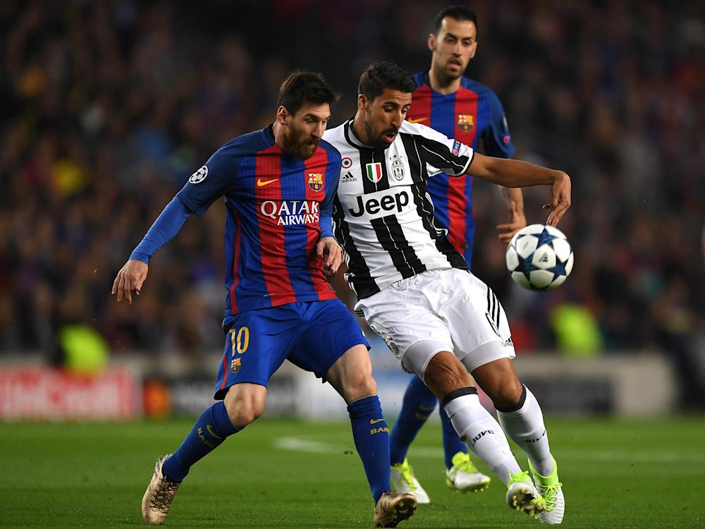 Lionel Messi battles with Sami Khedira for the ball: Getty