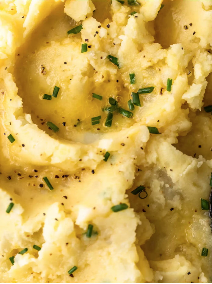 """<p>The secret to this dairy-free dish? Almond milk, vegan butter, and nutritional yeast.</p><p><strong>Get the recipe at <a href=""""https://www.thecookierookie.com/cheesy-vegan-mashed-potatoes-recipe-dairy-free-mashed-potatoes/"""" target=""""_blank"""">The Cookie Rookie</a>.</strong></p><p><strong><a class=""""body-btn-link"""" href=""""https://go.redirectingat.com?id=74968X1596630&url=https%3A%2F%2Fwww.walmart.com%2Fip%2FTOPINCN-Stainless-Steel-Potato-Masher-Fruit-Vegetable-Mashing-Tool-Home-Kitchen-Utensil-Tool%2F230129647&sref=http%3A%2F%2Fwww.countryliving.com%2Ffood-drinks%2Fg1050%2Fsimple-potato-recipes-1110%2F"""" target=""""_blank"""">SHOP POTATO MASHERS</a><br></strong></p>"""