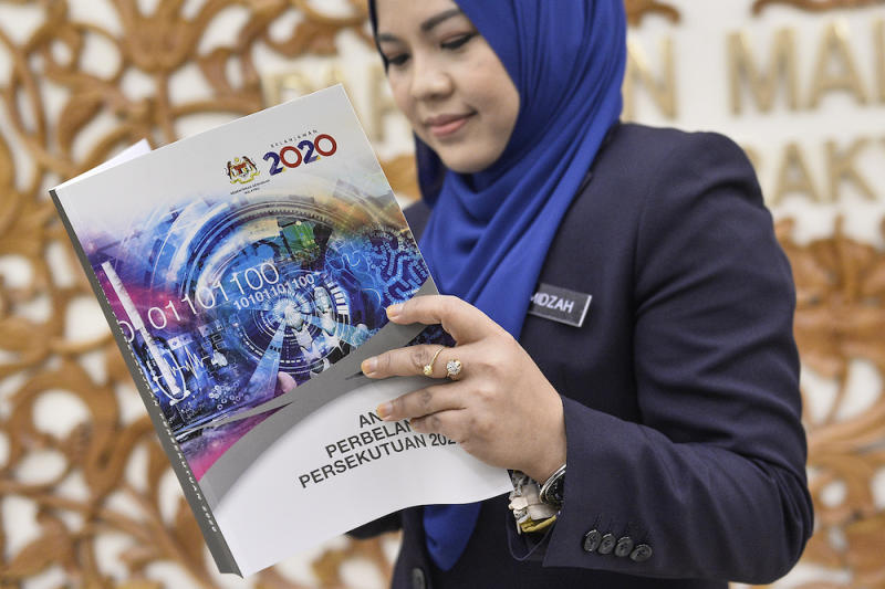 A woman holds copy of Budget 2020 after its tabling in Parliament October 11, 2019. — Picture by Miera Zulyana