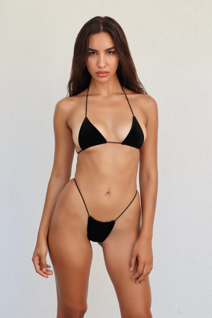 """<a href=""""https://www.refinery29.com/en-us/string-bikini"""" rel=""""nofollow noopener"""" target=""""_blank"""" data-ylk=""""slk:String bikinis"""" class=""""link rapid-noclick-resp"""">String bikinis</a> are still going strong this summer. <br> <br> <strong>MELISSA SIMONE</strong> Miya Onyl Velvet Top, $, available at <a href=""""https://go.skimresources.com/?id=30283X879131&url=https%3A%2F%2Fmelissasimoneswim.com%2Fcollections%2Fsale%2Fproducts%2Fonyx-velvet-top-pre-order"""" rel=""""nofollow noopener"""" target=""""_blank"""" data-ylk=""""slk:Melissa Simone"""" class=""""link rapid-noclick-resp"""">Melissa Simone</a> <br> <br> <strong>MELISSA SIMONE</strong> Miya Onyx Velvet Bottom, $, available at <a href=""""https://go.skimresources.com/?id=30283X879131&url=https%3A%2F%2Fmelissasimoneswim.com%2Fcollections%2Fsale%2Fproducts%2Fonyx-velvet-bottom-pre-order"""" rel=""""nofollow noopener"""" target=""""_blank"""" data-ylk=""""slk:Melissa Simone"""" class=""""link rapid-noclick-resp"""">Melissa Simone</a>"""