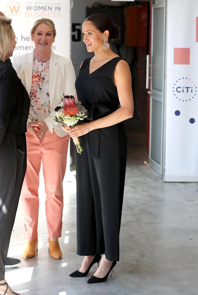 The Duchess of Sussex wearing her Everlane jumpsuit during the royal tour of South Africa on September 25, 2019. [Photo: Getty]