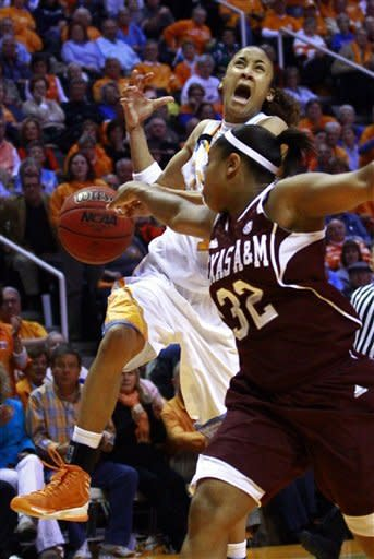 Tennessee guard Meighan Simmons (10) is fouled by Texas A&M guard Adrienne Pratcher (32) in the first half of an NCAA college basketball game, Thursday, Feb. 28, 2013, in Knoxville, Tenn. (AP Photo/Wade Payne)