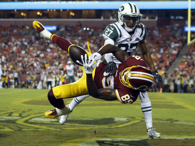 New York Jets cornerback Darryl Roberts (27) breaks up a pass intended for Washington Redskins wide receiver Cam Sims (89) during the first half of a preseason NFL football game Thursday, Aug. 16, 2018, in Landover, Md. (AP Photo/Alex Brandon)