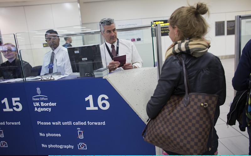 Passport control at Gatwick Airport - Credit: Oli Scarff/Getty Images