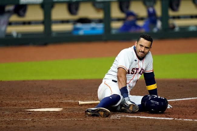 Astros' Correa fouls ball of ankle, X-rays negative