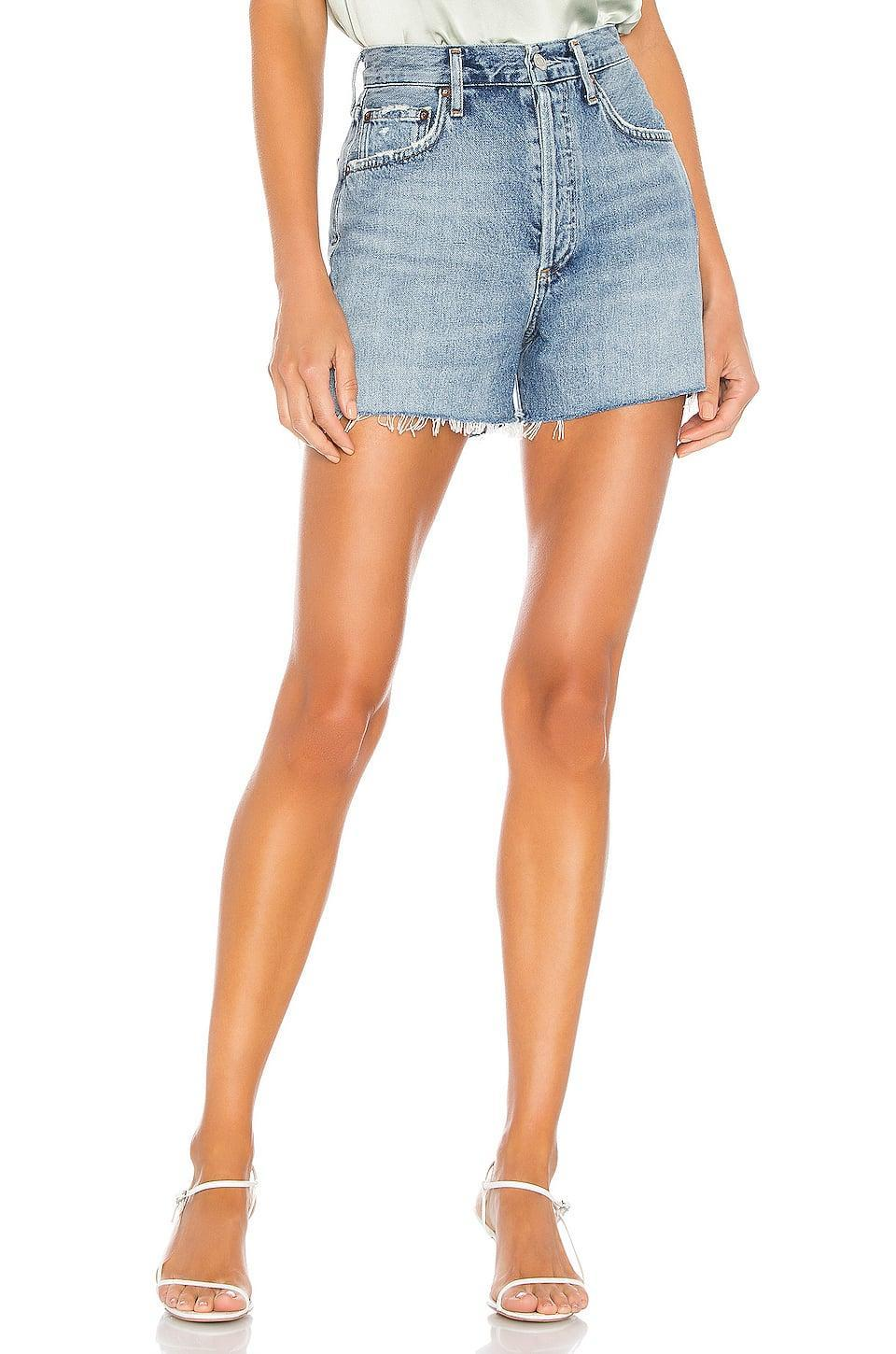 "<p>We love the slightly loose fit of these <a href=""https://www.popsugar.com/buy/Agolde-Dee-Super-High-Rise-Shorts-587738?p_name=Agolde%20Dee%20Super%20High%20Rise%20Shorts&retailer=revolve.com&pid=587738&price=128&evar1=fab%3Aus&evar9=45988379&evar98=https%3A%2F%2Fwww.popsugar.com%2Ffashion%2Fphoto-gallery%2F45988379%2Fimage%2F47603875%2FAgolde-Dee-Super-High-Rise-Shorts&list1=shopping%2Cdenim%2Cshorts%2Csummer%2Cdenim%20shorts%2Csummer%20fashion&prop13=mobile&pdata=1"" class=""link rapid-noclick-resp"" rel=""nofollow noopener"" target=""_blank"" data-ylk=""slk:Agolde Dee Super High Rise Shorts"">Agolde Dee Super High Rise Shorts</a> ($128).</p>"