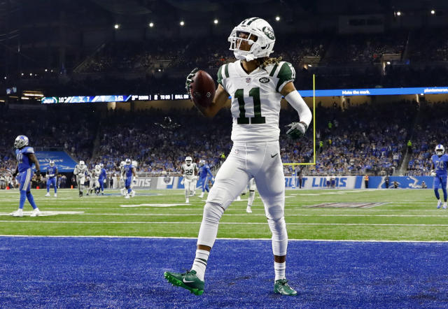 New York Jets wide receiver Robby Anderson (11) celebrates his 41-yard touchdown reception against the Detroit Lions during the first half of an NFL football game in Detroit, Monday, Sept. 10, 2018. (AP Photo/Rick Osentoski)