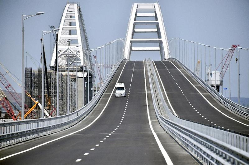 A vehicle passes over the 19 km road-and-rail Crimean Bridge over the Kerch Strait and linking southern Russia to the Crimean peninsula on May 15, 2018, prior to the opening ceremony (AFP Photo/Alexander NEMENOV)