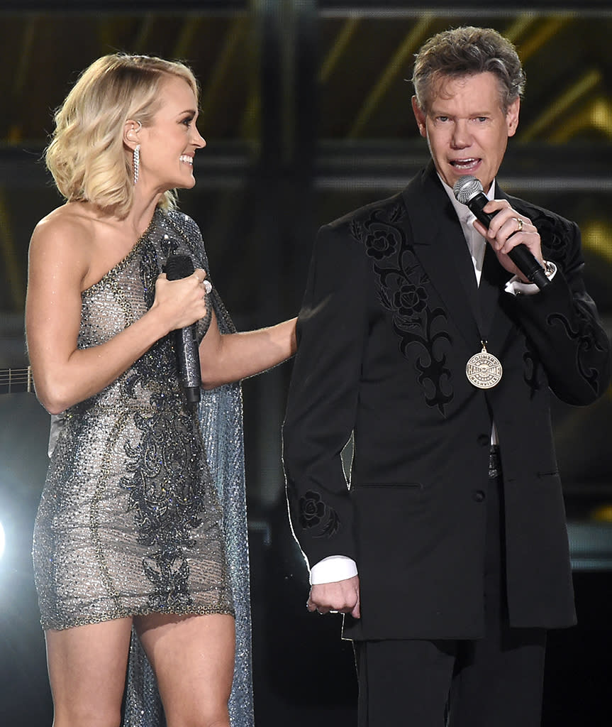 "<p>Randy Travis exited the insular world of country music and entered household name status in the most unfortunate of ways — following a series of highly publicized personal issues, he suffered a near-fatal stroke in 2013 which cost him his ability to speak or sing. It's been a long three years, but Travis has clearly been working very hard at rehabilitation — in 2016 he not only regained his speech, he managed to perform a chilling rendition of ""Amazing Grace"" at his October induction into the Country Music Hall of Fame. He followed this with an extremely brief but moving appearance at November's Country Music Association Awards (pictured), where he sang the final word of his hit ""Forever and Ever Amen."" The simple gesture drove everyone present, from Miranda Lambert to Garth Brooks, to tears. (Photo: Charles Sykes/Invision/AP) </p>"