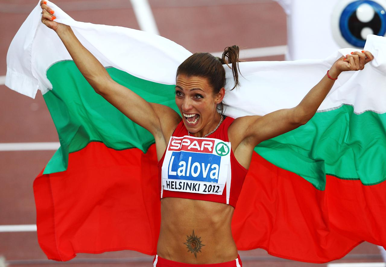 HELSINKI, FINLAND - JUNE 28:  Ivet Lalova of Bulgaria celebrates winning the Women's 100 Metres Final during day two of the 21st European Athletics Championships at the Olympic Stadium on June 28, 2012 in Helsinki, Finland  (Photo by Alexander Hassenstein/Bongarts/Getty Images)