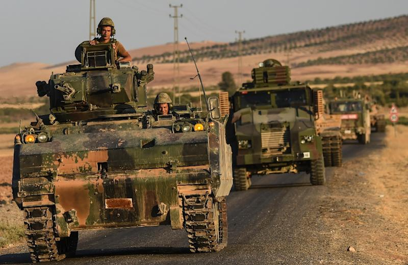 Turkish soldiers drive back to Turkey from the Syrian-Turkish border town of Jarabulus in September 2016