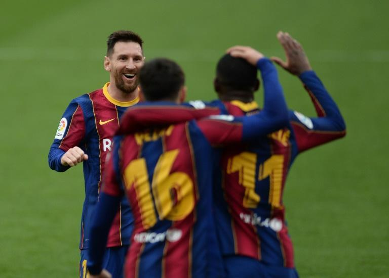 Lionel Messi (L) scored one goal and set up another in Barca's 2-0 win over Sevilla and is La Liga's top scorer