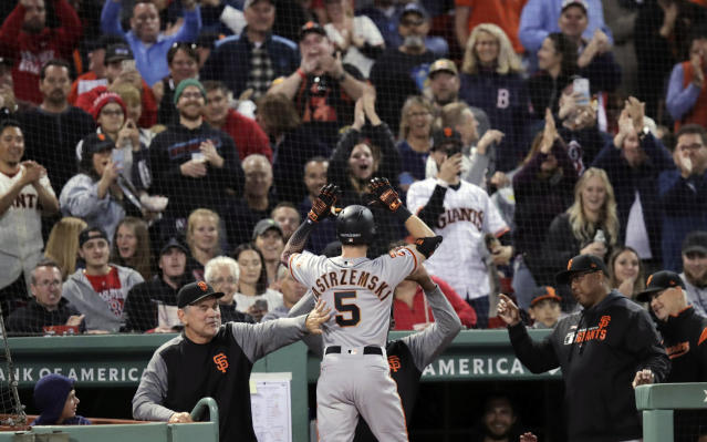 San Francisco Giants' Mike Yastrzemski (5) is congratulated after his solo home run in the fourth inning of a baseball game against the Boston Red Sox at Fenway Park in Boston, Tuesday, Sept. 17, 2019. Yastrzemski is the grandson of Red Sox great and Hall of Famer Carl Yastrzemski. (AP Photo/Charles Krupa)