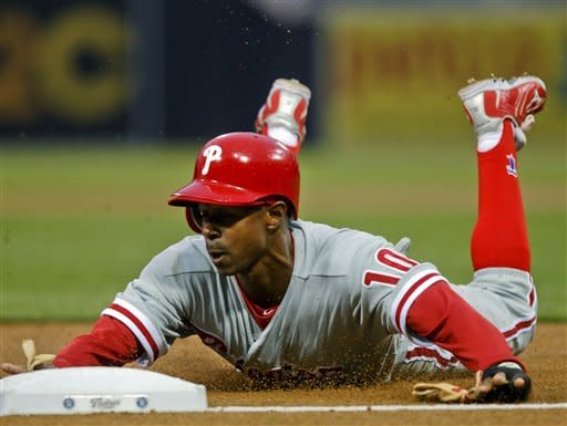 Philadelphia Phillies' Juan Pierre slides into third head first as he takes an extra base on an error by San Diego Padres left fielder Will Venable during the first inning of a baseball game Thursday, April 19, 2012, in San Diego. (AP Photo/Lenny Ignelzi)