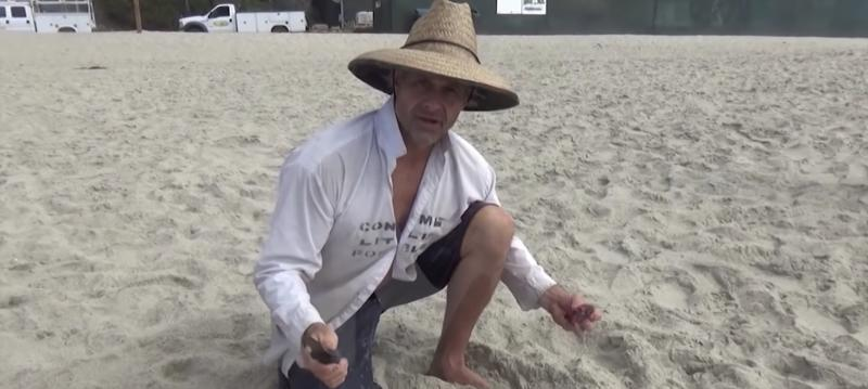 "TMZ obtained video of ""Naked and Afraid"" star Gary Golding cutting open a dead dolphin and eating its organs. (Photo: YouTube)"