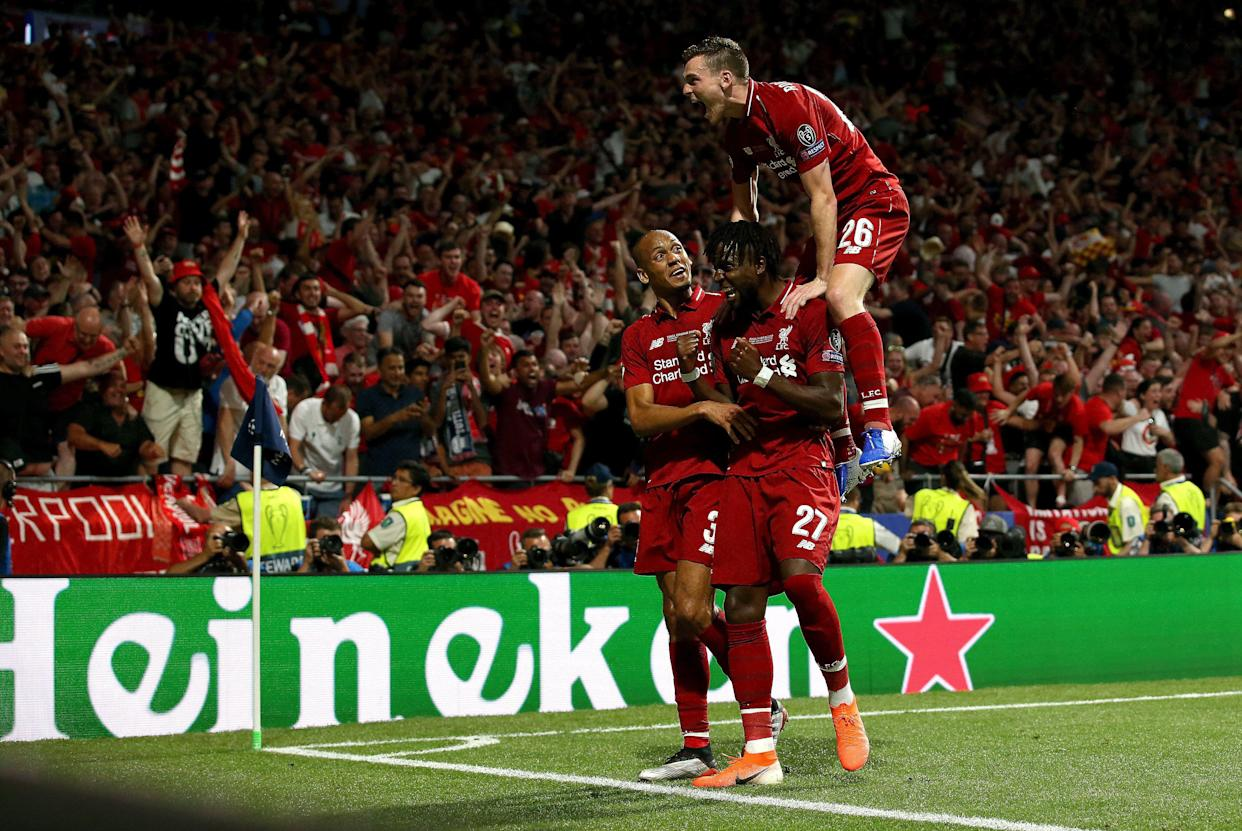 MADRID, SPAIN - JUNE 01: Divock Origi of Liverpool celebrates with teammates Fabinho and Andy Robertson after scoring his team's second goal during the UEFA Champions League Final between Tottenham Hotspur and Liverpool at Estadio Wanda Metropolitano on June 01, 2019 in Madrid, Spain. (Photo by Jan Kruger - UEFA/UEFA via Getty Images)