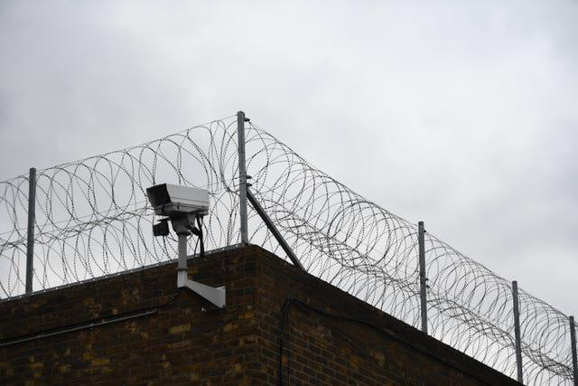 Barbed wire on a prion wall (Victoria Jones/PA)