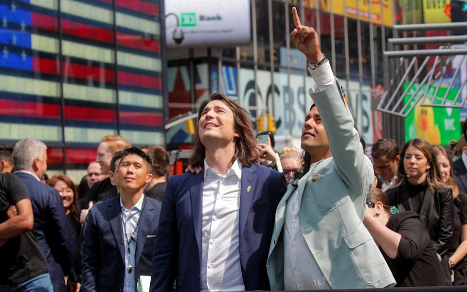Vlad Tenev and Baiju Bhatt, co-founders of Robinhood, attend their company's IPO at the Nasdaq in New York's Times Square - BRENDAN MCDERMID/Reuters