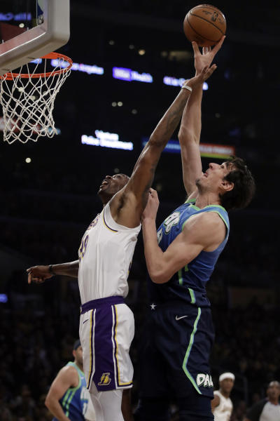 Los Angeles Lakers' Dwight Howard, left, works for a rebound against Dallas Mavericks' Boban Marjanovic during the first half of an NBA basketball game Sunday, Dec. 1, 2019, in Los Angeles. (AP Photo/Marcio Jose Sanchez)