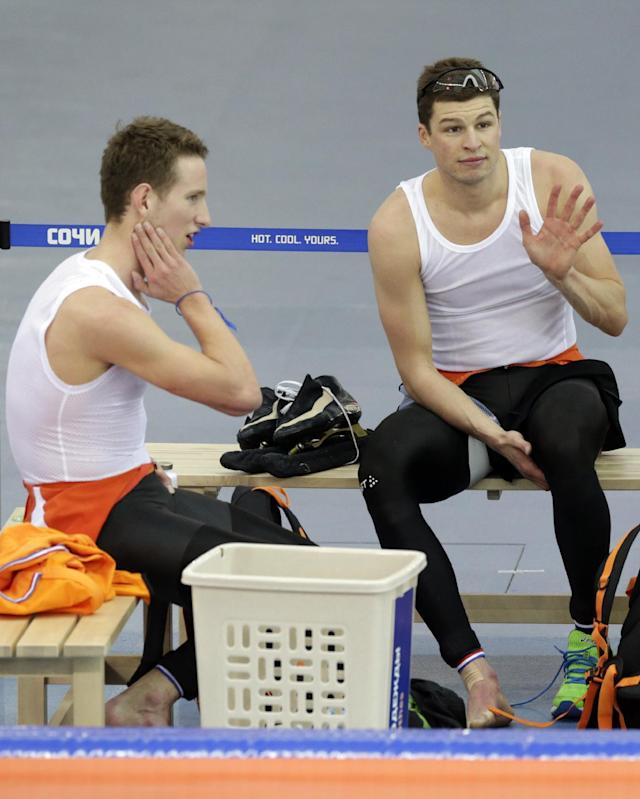Sven Kramer of the Netherlands, right, waves as teammate Jan Blokhuijsen sits beside him after the men's speedskating team pursuit semifinals at the Adler Arena Skating Center at the 2014 Winter Olympics, Friday, Feb. 21, 2014, in Sochi, Russia. (AP Photo/Matt Dunham)
