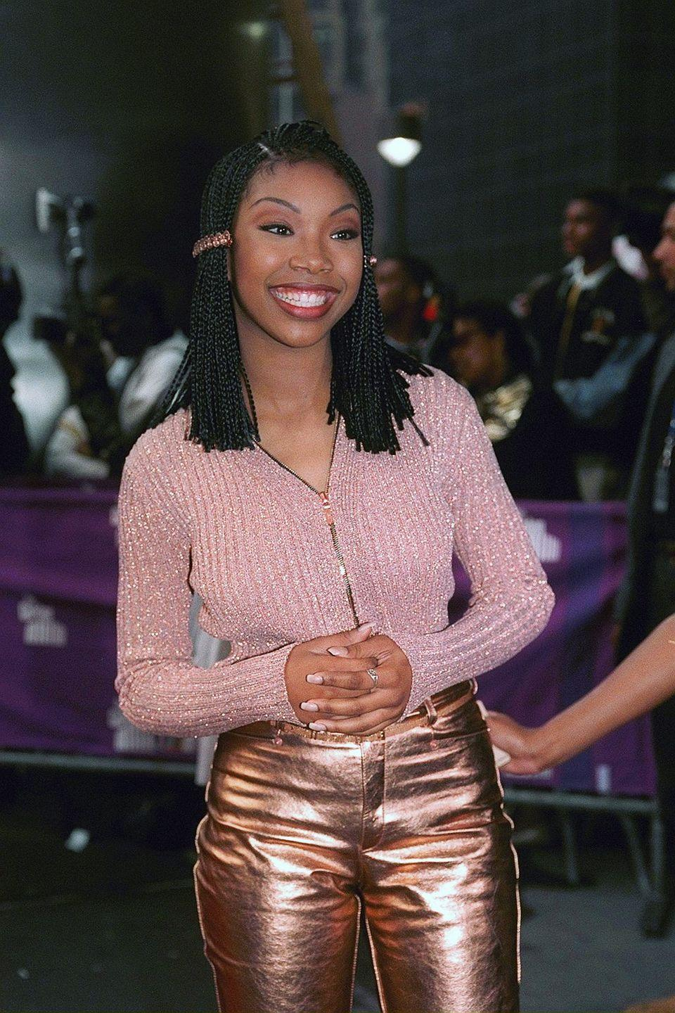 <p>Brandy Norwood dominated the '90s as both a huge music star and an actress. Her self-titled album, <em>Brandy</em>, was as big hit, and she also had starring roles in the show <em>Moesha</em> and an adaptation of <em>Cinderella</em>. She continued to put out new music throughout the decade. </p>
