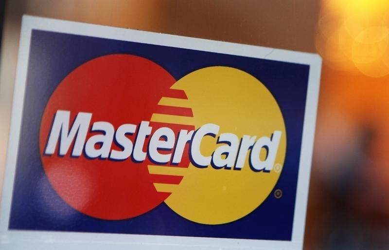 A MasterCard logo is seen on a door outside a restaurant in New York
