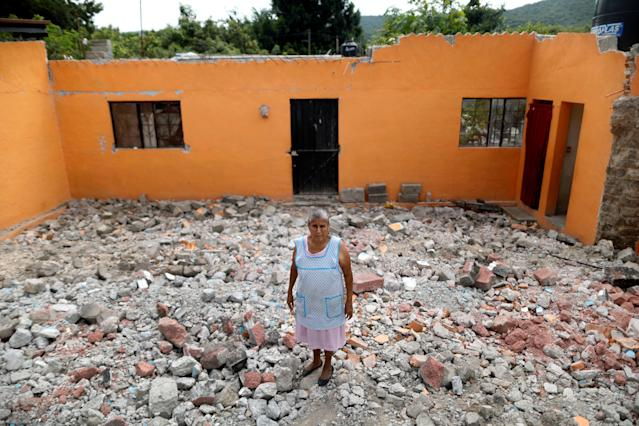 "<p>Ventura Sanchez, 63, housewife, poses for a portrait on the rubble of her house after an earthquake in La Nopalera, Mexico, September 27, 2017. The house was badly damaged but with the help of her family Ventura rescued some furniture. She is living in her backyard and hopes for her house to be rebuilt. ""I hope the authorities do not deceive us with promises. I am very sad,"" she said. (Photo: Edgard Garrido/Reuters) </p>"