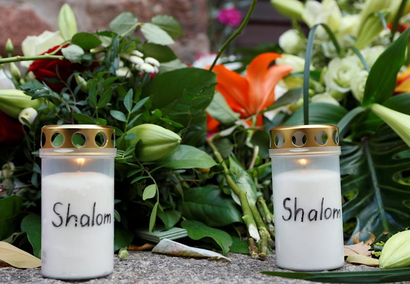 Flowers and candles are seen outside the synagogue in Halle, Germany, October 10, 2019, after two people were killed in a shooting. (Photo: Fabrizio Bensch / Reuters)