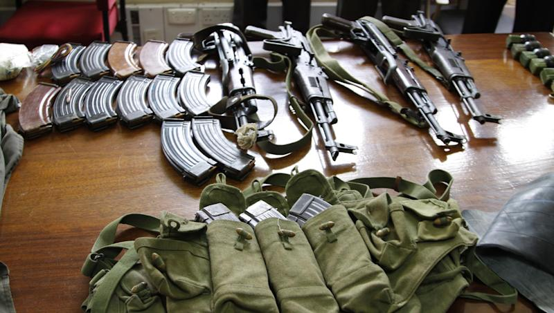 Some of the arms and  ammunition recovered by police  displayed in Nairobi, Kenya, Friday, Sep. 14, 2012. Kenyan police say they have arrested two people suspected to have links with an al-Qaida-linked Somali militant group that was in the last stages of planning a major terrorist attack on Kenya.  Boniface Mwaniki , the head of Kenya's Anti-Terrorism Police Unit, said Friday that police found four suicide vests, a cache of weapons and 12 grenades.(AP Photo/Khalil Senosi)