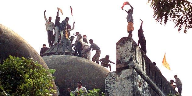 Hindu youths clamour atop the 16th century Babri Mosque on 6 December 1992.