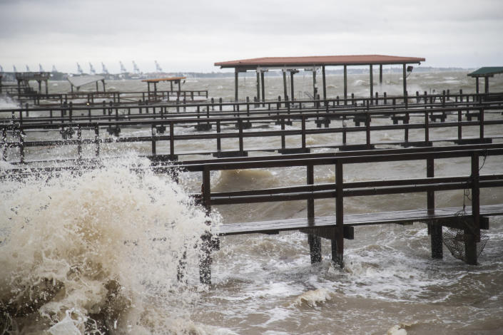 Hight tide begins at the Light House District ahead of Tropical Storm Beta Monday, Sept. 21, 2020 in Kemah, Texas. (Marie D. De Jesús/Houston Chronicle via AP)