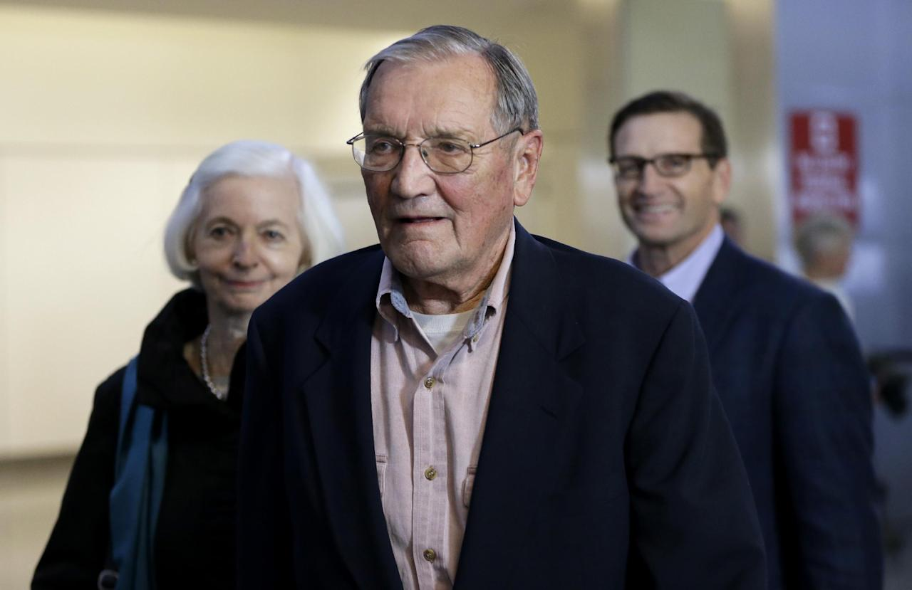 Merrill Newman, center, walks beside his wife Lee, left, and his son Jeffrey after arriving at San Francisco International Airport on Saturday, Dec. 7, 2013. Newman was detained in North Korea late October at the end of a 10-day trip to North Korea, a visit that came six decades after he oversaw a group of South Korean wartime guerrillas during the 1950-53 war. He was released from North Korea early Saturday. (AP Photo/Ben Margot)