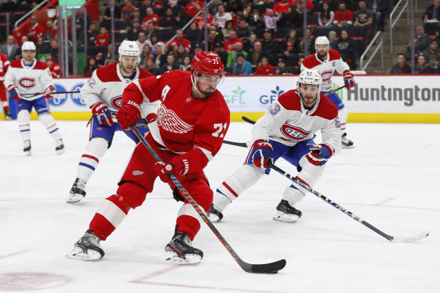 Detroit Red Wings center Dylan Larkin (71) back hands a shot against the Montreal Canadiens in the second period of an NHL hockey game, Tuesday, Feb. 26, 2019, in Detroit. (AP Photo/Paul Sancya)