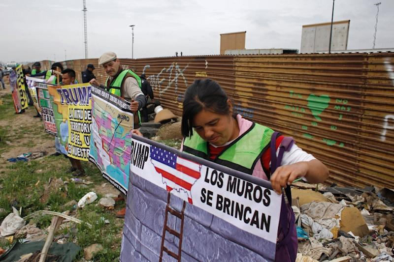 Before Trump's visit, demonstrators protested his migration policies on the Mexican side of the border in Tijuana (AFP Photo/Guillermo Arias)